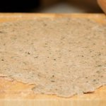 Roll the dough into a 12-inch circle on a lightly floured surface.