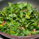 Stir in chard leaves and 2 tablespoons water.