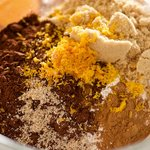 In large bowl combine flour, sugar, cocoa powder, grated orange peel, baking soda, cinnamon and nutmeg.