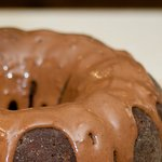 The cake is well glazed by chocolate glaze, shiny and smooth.