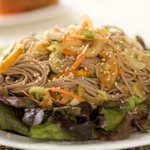 Then arrange the soba noodle salad on top of the lettuce.