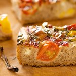 Juicy tomato, melted and brown cheese and roasted hot and sweet pepers are all in one bite of this delicious bread!