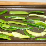 Put the chili strips on a large baking sheet and drizzle over 2 tablespoons olive oil.