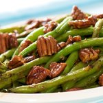 A quick, easy and delicious skillet green beans with butter-maple pecans!