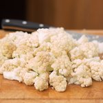 Trim off the ends of the cauliflower, and cut into small florets.