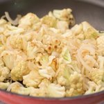 Keep cooking until the cauliflower florets starts to brown and onions are soft, 4 to 5 minutes.