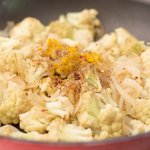Add the spice mixture into partially cooked cauliflower and onion.