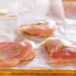 Add a layer of prosciutto onto each chicken cutlet, press to adhere