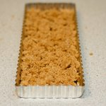 Turn dough out into tart pan coated with cooking spray (it will be crumbly),