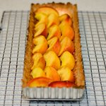 Arrange peach slices neatly over tart.