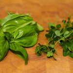 Make the dressing first, wash the fresh herbs and pat dry.