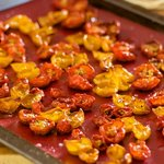 Roast in 250 degrees F oven for about 2 hours until the cherry tomatoes are shrivelled and flavors are concentrated.