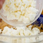 Add the feta cheese into the flour-egg mixture.