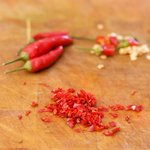 Add some fresh and seeded chili peppers if using.