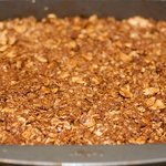 and place the granola mixture into a 9 x9-inch square baking ban coated with cooking spray.