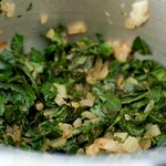 Add the kale into the cooked onions and saute, stirring, cook until wilted about 2 minutes.