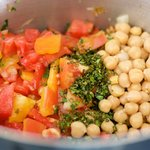 Add the chick peas, tomatoes, herbs,