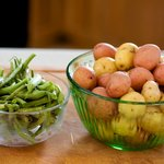 First, let's get the green beans and new potatoes well washed and snap off the ends of the green beans.