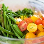 Place the green beans, tomatoes, parsley and basil into the large bowl with the seasoned potatoes.