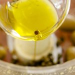 Pour in the olive oil or any vegetable oil.