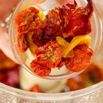 Add the sun-dried or oven-dried tomatoes.