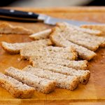 Using a bread knife cut the bread into 1-inch slices first.