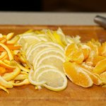 Separate the pulp and peel of oranges, thinly slice the whole lemon and orange peel.