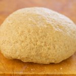 Use your hand to knead the dough a few times more until a soft ball forms.