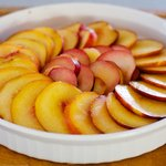 Lay the sliced peaches or nectarines and plums at a neat pattern over the almond topping.