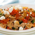 Warm Pasta with Roasted Tomatoes, Greens and Goat Cheese
