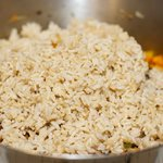 Add the rice into the pan or wok,