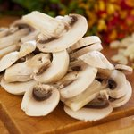 Slice 4 to 5 white button mushrooms.