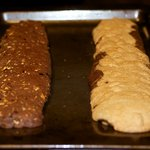Baking process. The dough on the left is chocolate walnut biscotti.
