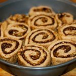 Arrange the cinnamon rolls close together in the pan.