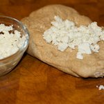 Knead the crumbled goat cheese into the dough