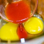 In a medium bowl, add the eggs, hot sauce,