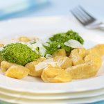 Blue pumpkin gnocchi with spinach pesto