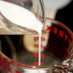 In a separate bowl or measuring cup, pour the milk,