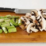 Slice the mushrooms and cut the asparagus into 1-inch pieces.