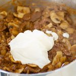 Stir in sour cream; cook,