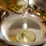 Next pour vegetable oil into a large bowl.