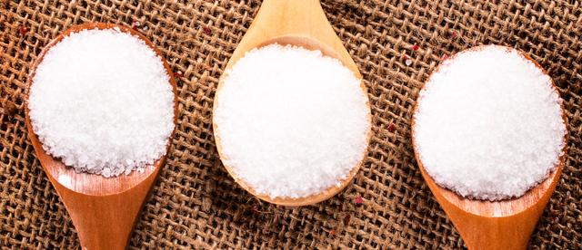 Salt crystals for brining turkey on wooden spoons