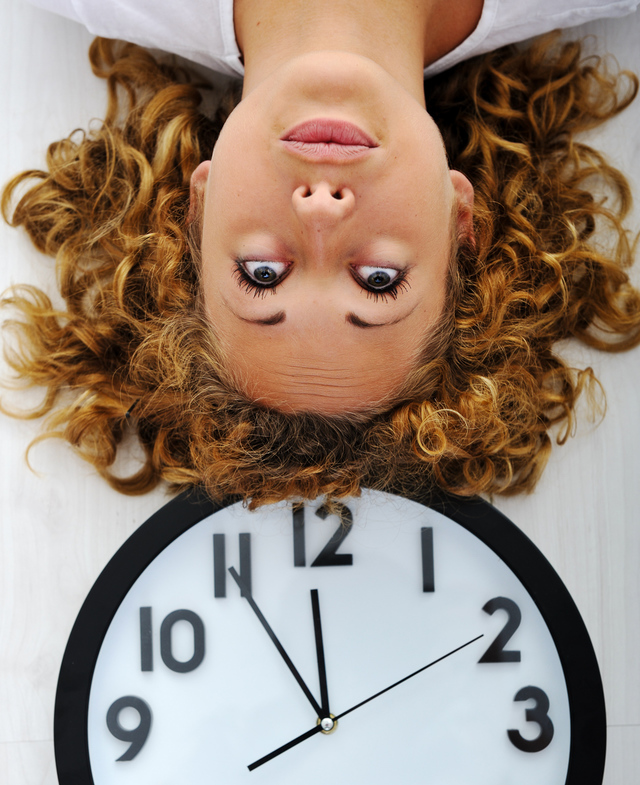 Upside down girl and clock