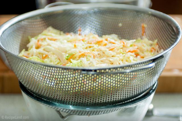 Draining the coleslaw