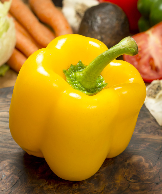 whole yellow sweet bell pepper