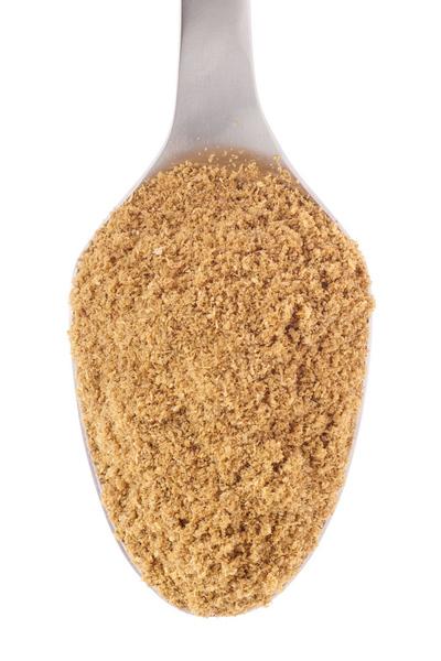 ground coriander on a spoon