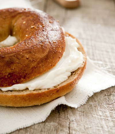 light cream cheese on a bagel