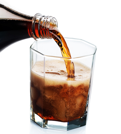 cola soda pouring into glass